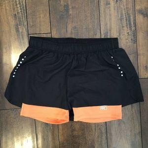 Crivit Pro lined shorts black/coral Sz small